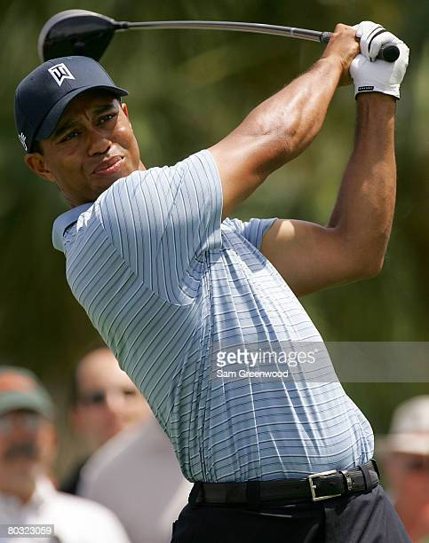 Tiger Woods of the USA plays a shot on the 7th hole during the first round of the World Golf Championships CA Championship at the Doral Golf Resort &...