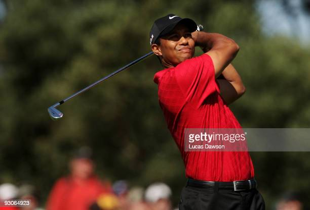 Tiger Woods of the USA plays an approach shot on the 16th hole during the final round of the 2009 Australian Masters at Kingston Heath Golf Club on...