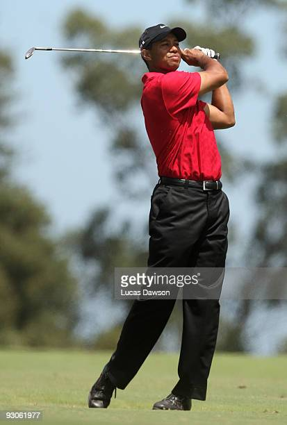 Tiger Woods of the USA plays an approach shot on the 3rd hole during the final round of the 2009 Australian Masters at Kingston Heath Golf Club on...