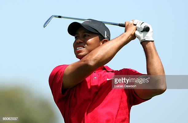 Tiger Woods of the USA plays an approach shot on the 4th hole during the final round of the 2009 Australian Masters at Kingston Heath Golf Club on...