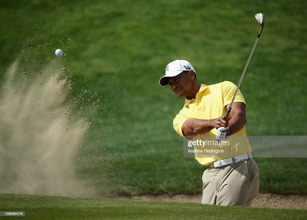 Tiger Woods of the USA plays from a bunker during the Pro Am prior to the start of The Abu Dhabi HSBC Golf Championship at Abu Dhabi Golf Club on January 16, 2013 in Abu Dhabi, United Arab Emirates.