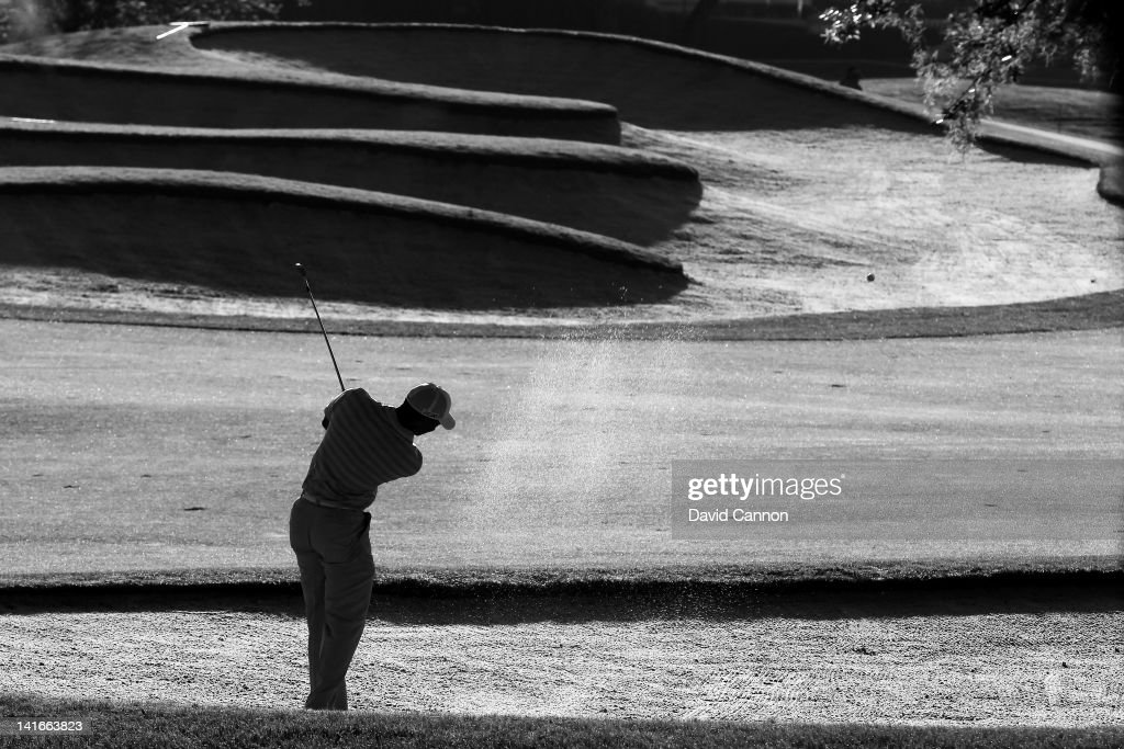 Tiger Woods of the USA plays from a fairway bunker against the early morning sun during the pro-am as a preview for the 2012 Arnold Palmer Invitational presented by MasterCard at Bay Hill Club and Lodge on March 21, 2012 in Orlando, Florida.