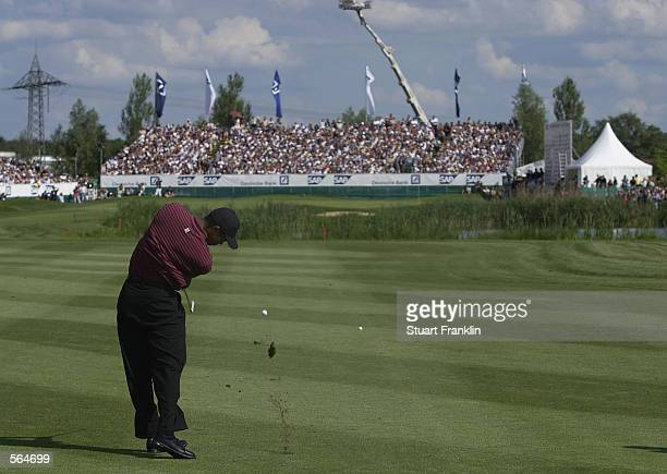 Tiger Woods of the USA plays his approach to the 18th green during the final round of the Deutsche Bank SAP Open at the St LeonRot Golf Club Germany...
