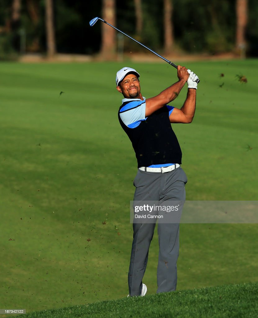 Tiger Woods of the USA plays his second shot at the par 4, 12th hole during the completion of his first round on day two of the 2013 Turkish Airlines Open on the Montgomerie Maxx Royal Course on November 8, 2013 in Antalya, Turkey.