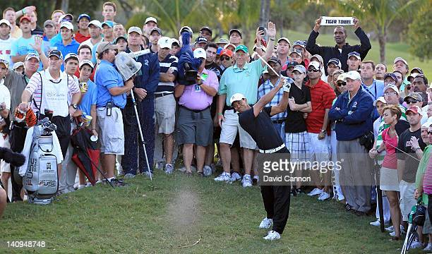 Tiger Woods of the USA plays his second shot at the par 4 18th hole during the first round of the World Golf Championship Cadillac Championship on...