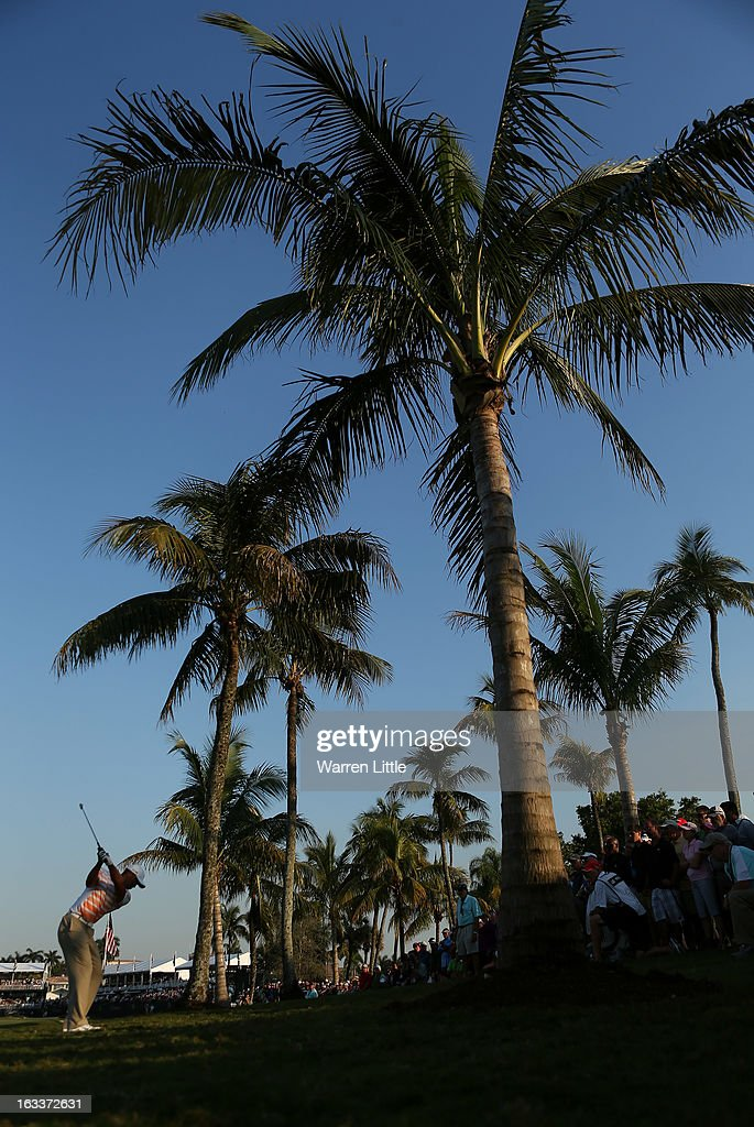 Tiger Woods of the USA plays his second shot into the 18th green during the second round of the WGC - Cadillac Championship at the Trump Doral Golf Resort & Spa on March 8, 2013 in Doral, Florida.