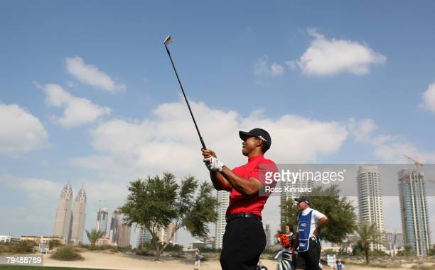 Tiger Woods of the USA plays his second shot on the par four 8th hole during the final round of the Dubai Desert Classic on the Majlis Course held at...
