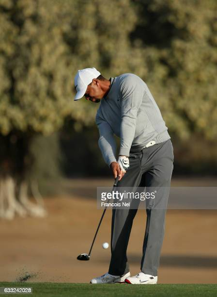 Tiger Woods of the USA plays his second shot on the third hole during the pro-am event prior to the Omega Dubai Desert Classic on the Majlis Course...