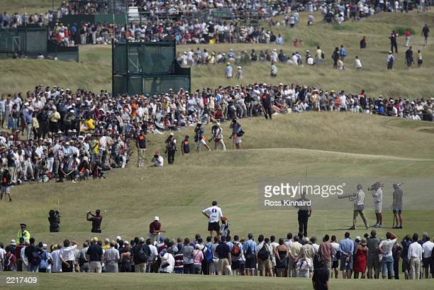 Tiger Woods of the USA plays his second shot to the first hole during the final round of the Open Championship at the Royal St George's course on...
