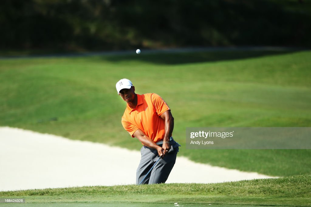 Tiger Woods of the USA plays his third shot on the 11th hole during round one of THE PLAYERS Championship at THE PLAYERS Stadium course at TPC Sawgrass on May 9, 2013 in Ponte Vedra Beach, Florida.