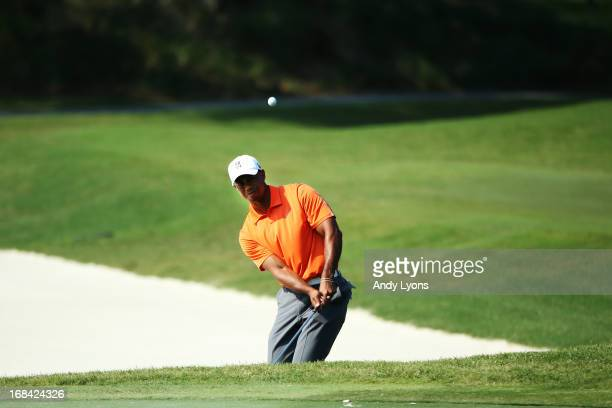 Tiger Woods of the USA plays his third shot on the 11th hole during round one of THE PLAYERS Championship at THE PLAYERS Stadium course at TPC...