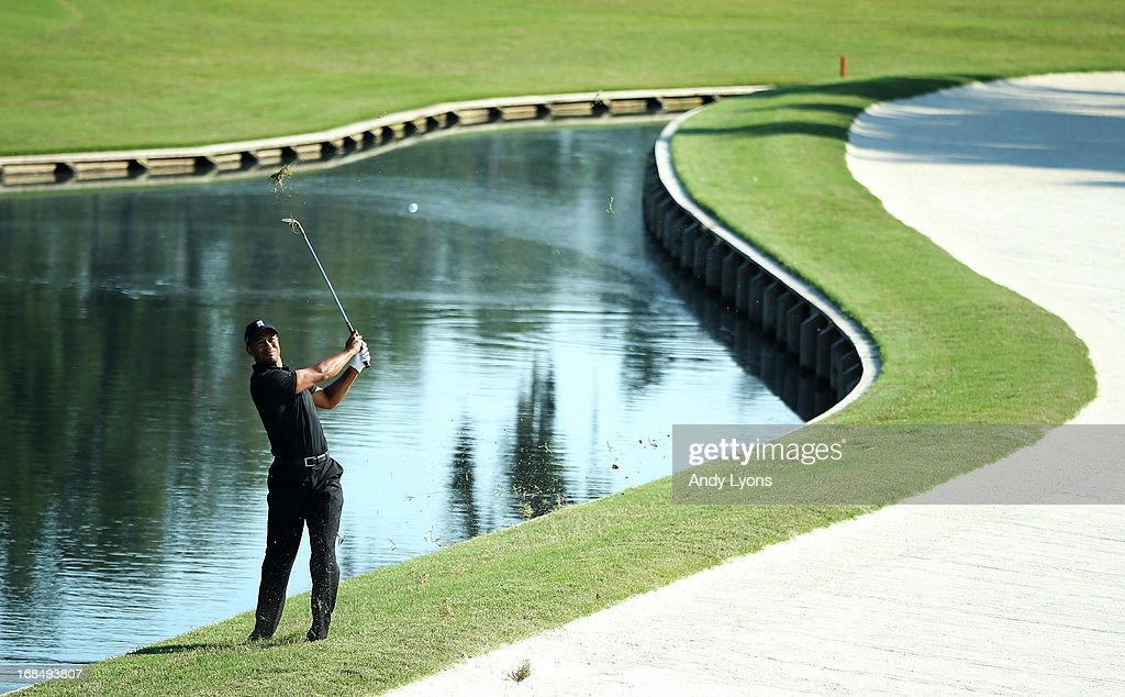 Tiger Woods of the USA plays his third shot on the 11th hole during round two of THE PLAYERS Championship at THE PLAYERS Stadium course at TPC Sawgrass on May 10, 2013 in Ponte Vedra Beach, Florida. Woods hit into the bunker.
