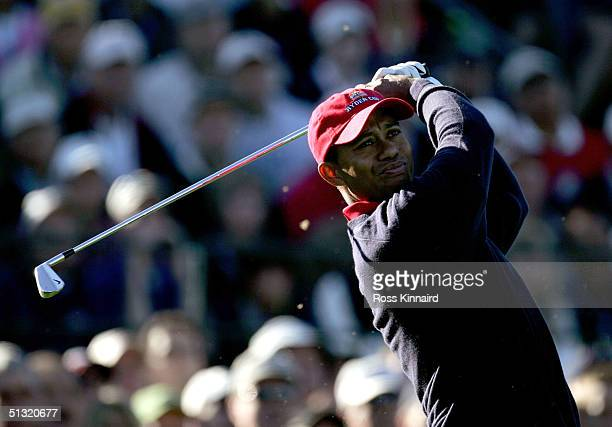 Tiger Woods of the USA plays off the third tee during his four-ball match against European team players Darren Clarke and Ian Poulter in the morning...