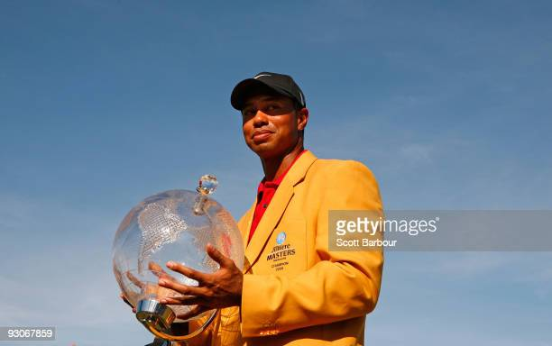 Tiger Woods of the USA poses with the trophy after the final round of the 2009 Australian Masters at Kingston Heath Golf Club on November 15, 2009 in...
