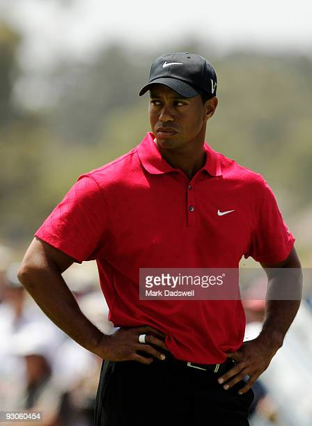 Tiger Woods of the USA prepares to play an approach shot on the 1st hole during the final round of the 2009 Australian Masters at Kingston Heath Golf...