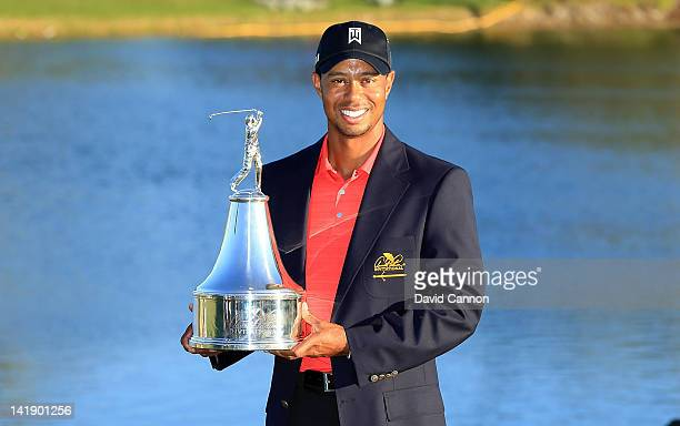 Tiger Woods of the USA proudly holds the trophy during the final round of the 2012 Arnold Palmer Invitational presented by MasterCard at Bay Hill...