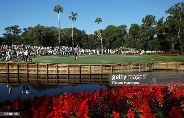 Tiger Woods of the USA putts on the 13th green during round two of THE PLAYERS Championship at THE PLAYERS Stadium course at TPC Sawgrass on May 10,...
