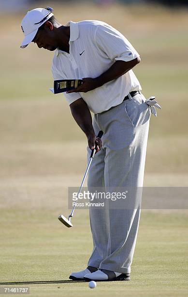 Tiger Woods of the USA putts with one hand on the 8th green during a practice round at the Royal Liverpool Golf Club on July 17, 2006 in Hoylake,...