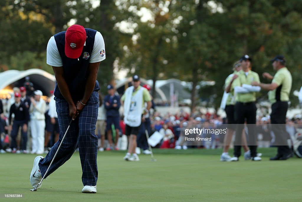 Tiger Woods of the USA reacts to a missed birdie putt on the 18th green during the Afternoon Four-Ball Matches for The 39th Ryder Cup at Medinah Country Club on September 28, 2012 in Medinah, Illinois.