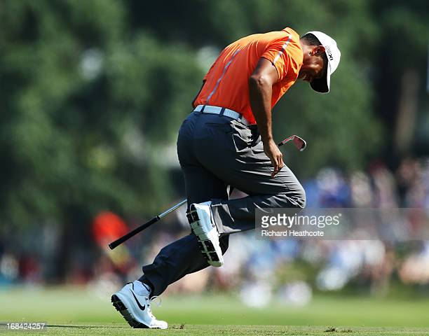 Tiger Woods of the USA reacts to his second shot on the 11th hole during round one of THE PLAYERS Championship at THE PLAYERS Stadium course at TPC...