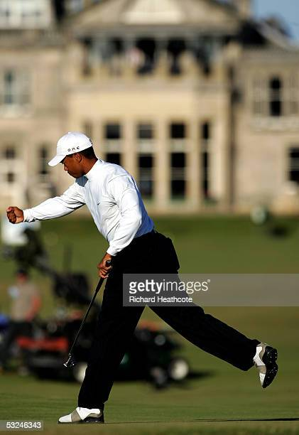 Tiger Woods of the USA reacts to making his par putt on the 17th green during the third round of the 134th Open Championship at Old Course St Andrews...