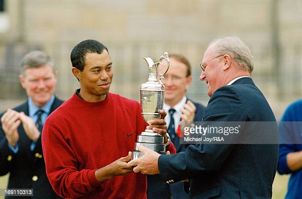 Tiger Woods of the USA receives the Claret Jug from Sir Michael Bonallack the Captain of the Royal and Ancient Golf Club of St Andrews after his...