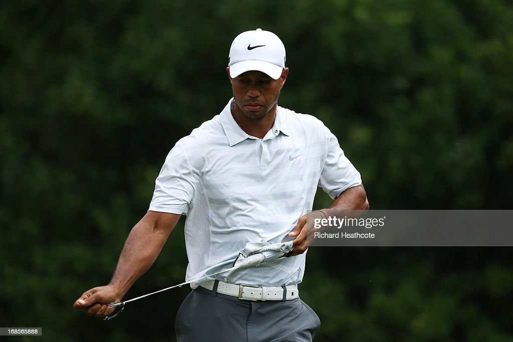 Tiger Woods of the USA rips his glove from his hand after playing a shot from the 11th tee during round three of THE PLAYERS Championship at THE PLAYERS Stadium course at TPC Sawgrass on May 11, 2013 in Ponte Vedra Beach, Florida.