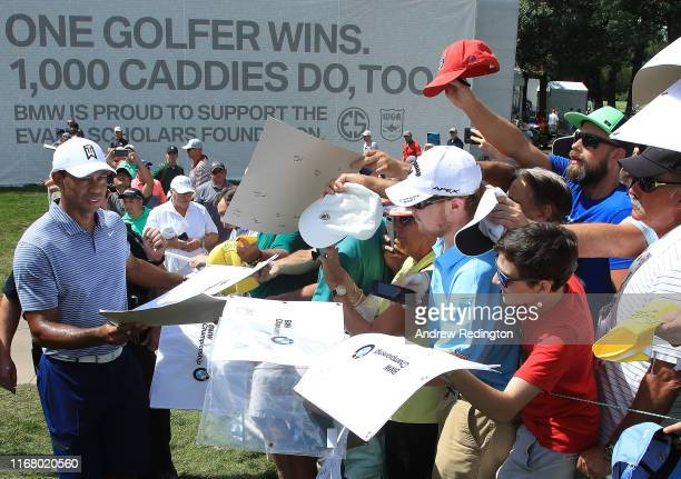 Tiger Woods of the USA signs autpgraphs during practice for the BMW Championship at Medinah Country Club on August 13 2019 in Medinah Illinois