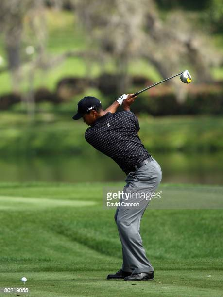 Tiger Woods of the USA starting his downswing as he hits his tee shot to the 16th hole during the pro-am for the 2008 Arnold Palmer Invitational...