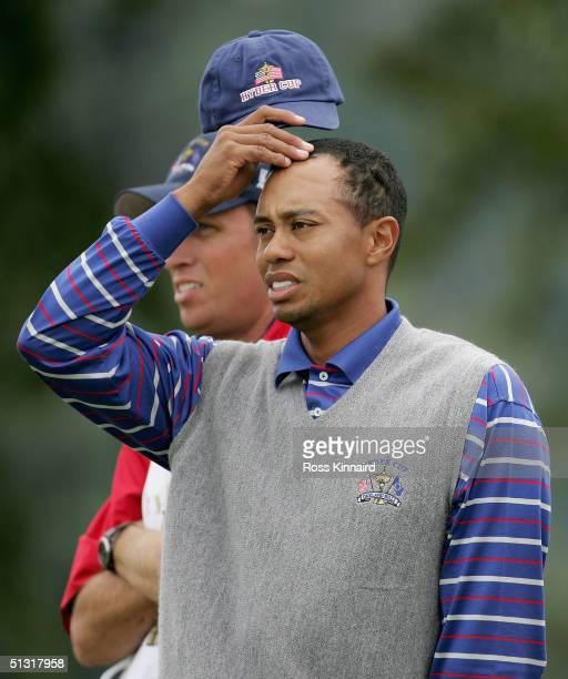 Tiger Woods of the USA stratches his head after his four-ball defeat against Colin Montgomerie and Padraig Harrington of Europe in the morning...