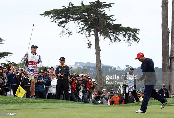 Tiger Woods of the USA Team birdies the 9th hole in his match against Y.E.Yang of South Korea and the International Team during the Day Four Singles...