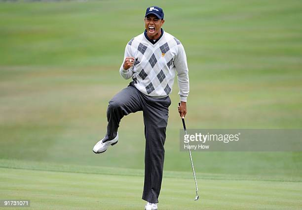 Tiger Woods of the USA Team celebrates his putt for a birdie to win the 17th hole during the Day Three Morning Foursome Matches of The Presidents Cup...
