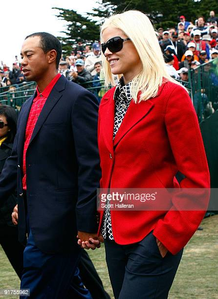 Tiger Woods of the USA Team walks with his wife Elin to the closing cermonies during the Final Round Singles Matches of The Presidents Cup at Harding...