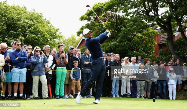 Tiger Woods of the USA tees off on the 5th hole during a practice round ahead of the 143rd Open Championship at Royal Liverpool on July 13 2014 in...
