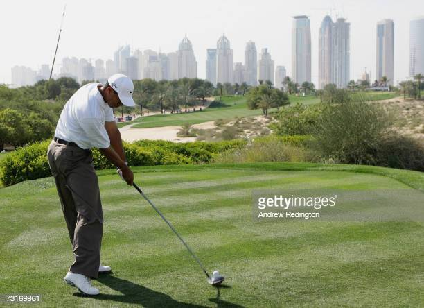 Tiger Woods of the USA tees off on the eighth hole during the first round of the Dubai Desert Classic on the Majilis Course at Emirates Golf Club on...