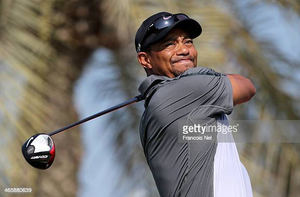 Tiger Woods of the USA tees off on the third hole during the first round of the 2014 Omega Dubai Desert Classic on the Majlis Course at the Emirates...
