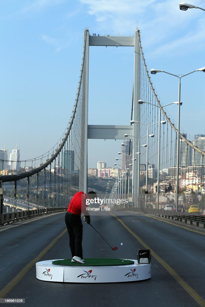 Tiger Woods of the USA the World Number One makes history as he hits the first golf shots from East to West on Istanbul's iconic Bosphorous Bridge linking Asia and Europe on November 5, 2013 in Istanbul, Turkey.