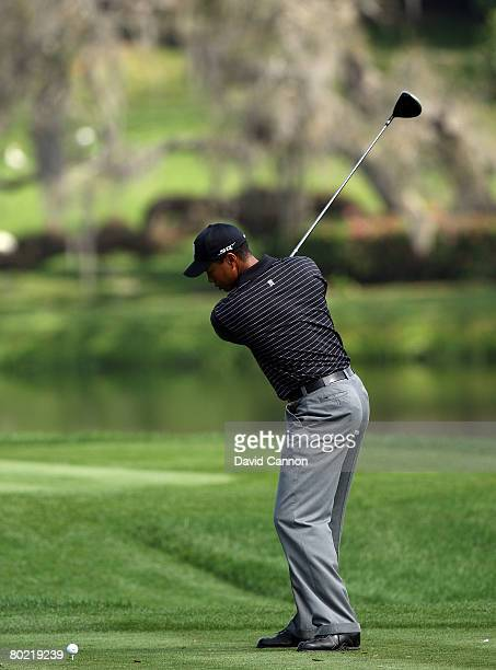 Tiger Woods of the USA three-quarters through his takeaway as he hits his tee shot to the 16th hole during the pro-am for the 2008 Arnold Palmer...