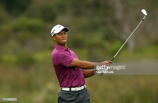 Tiger Woods of the USA watches his second shot at the 1st hole during day one of the 2011 Emirates Australian Open at The Lakes Golf Club at The...