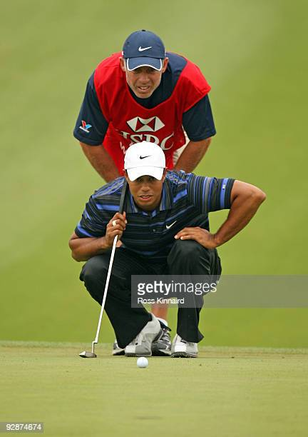 Tiger Woods of the USA with his caddie Steve Williams on the 14th green during the third round of the WGC HSBC Champions at Sheshan International...