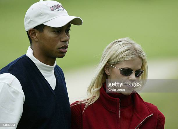 Tiger Woods of the USA with his girlfriend Elin Nordegren on the 17th green after his defeat in the afternoon foursomes on the first day of the 34th...