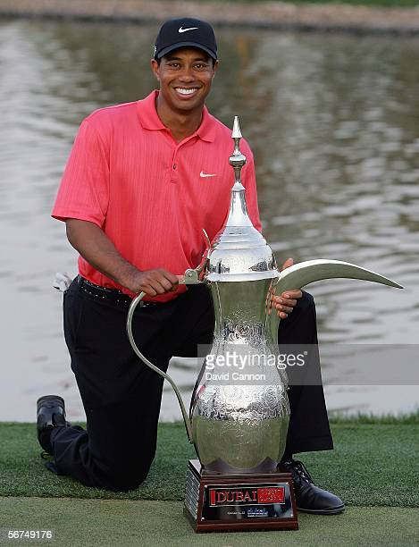 Tiger Woods of the USA with the trophy after the final round of the 2006 Dubai Desert Classic on the Majilis Course at the Emirates Golf Club on...