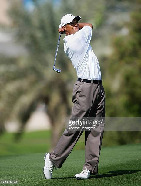 Tiger Woods of thr USA hits his second shot on the third hole during the first round of the Dubai Desert Classic on the Majilis Course at Emirates...