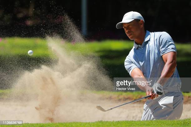 Tiger Woods of United States plays his shot from the 18th tee during the first round of World Golf ChampionshipsMexico Championship at Club de Golf...