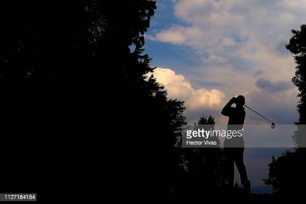 Tiger Woods of United States plays his shot on the 11th hole during the final round of World Golf Championships-Mexico Championship at Club de Golf...
