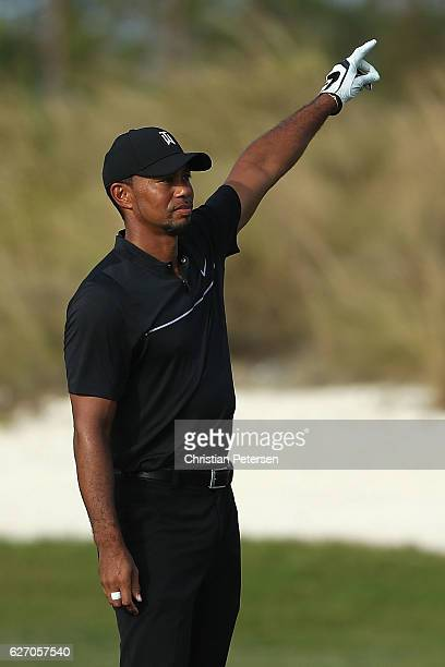 Tiger Woods of United States reacts to his second shot on the 16th hole during round one of the Hero World Challenge at Albany The Bahamas on...