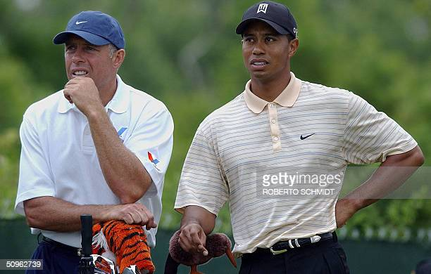 Tiger Woods of US and his caddie Steve Williams watch a tee shot during a practice round of the 104th US Open Championship at the Shinnecock Hills...