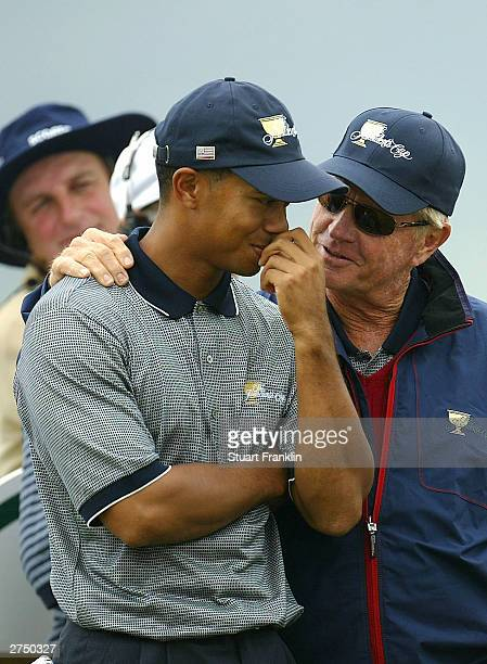 Tiger Woods of USA and Captain Jack Nicklaus chat during the first round of fourballs at The Presidents Cup between USA and The International team at...