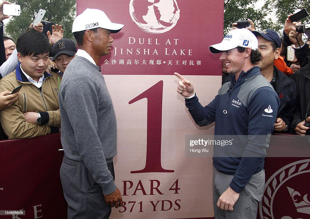 Tiger Woods of USA (L) and Rory McIlroy of Northern Ireland attend a photocall before the Duel of Tiger Woods and Rory McIlroy at Jinsha Lake Golf Club on October 29, 2012 in Zhengzhou, China.