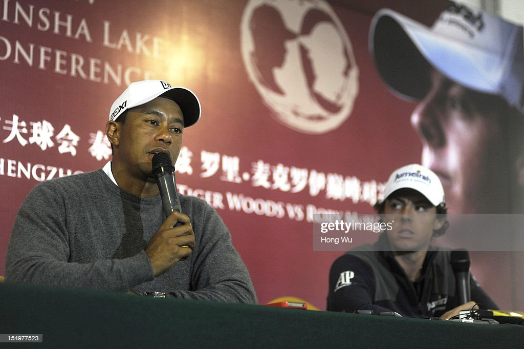 Tiger Woods of USA(L) and Rory McIlroy of Northern Ireland attend the press conference during the Duel of Tiger Woods and Rory McIlroy at Jinsha Lake Golf Club on October 29, 2012 in Zhengzhou, China.